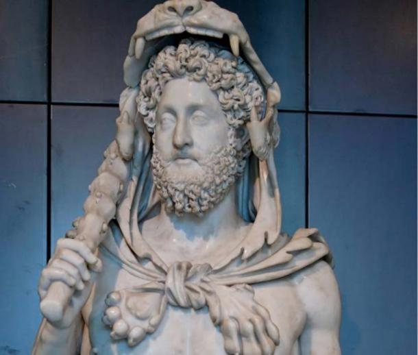 Bust of Commodus as Hercules, hence the lion skin, the club. Roman Artwork. (Public Domain)