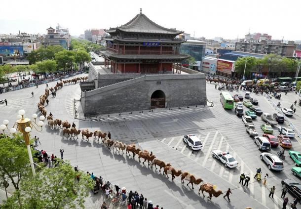 Camels and tea merchants wind through the streets of Zhangye as they retrace the ancient Silk Road route to Kazakhstan.
