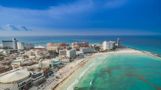 Cancun, Mexico, is a global tourist destination located miles from traditional Maya villages. Dronepicr/Wikicommons, CC BY