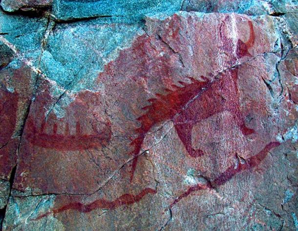 Canoe (top left), Michipeshu (top right), and two giant serpents (chignebikoogs), panel VIII, Agawa Rock, Lake Superior Provincial Park, Ontario, Canada. (D. Gordon E. Robertson/CC BY SA 3.0)