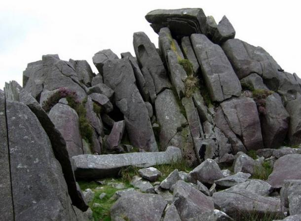 Carn Menyn bluestones. These dolerite slabs, split by frost action, seem to be stacked ready for the taking, and many have been removed over the centuries for local use