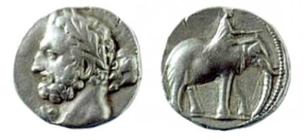 A Carthaginian shekel, dated 237-227 BC, depicting the Punic god Melqart (equivalent of Hercules/Heracles), most likely with the features of Hamilcar Barca, father of Hannibal Barca; on the reverse is a man riding an elephant.