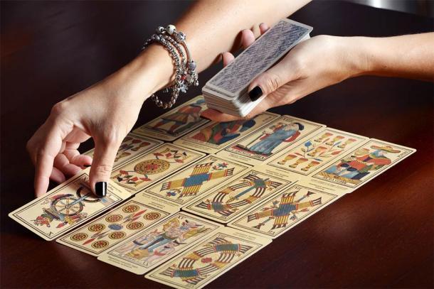 Cartomancy, the art of fortune-telling using tarot cards, has seen a resurgence. Credit: photology1971 / Adobe Stock