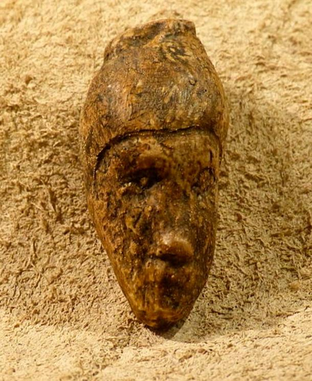 Carved female head from Dolni Vestonice, Krahuletz-Museum.