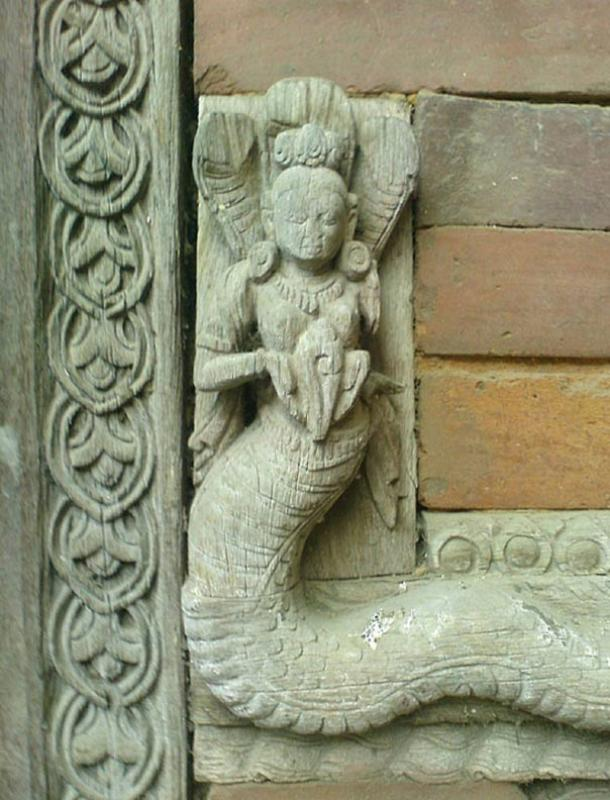 Carving of a Naga, one of many wrought from wood or stone to be found throughout Asia