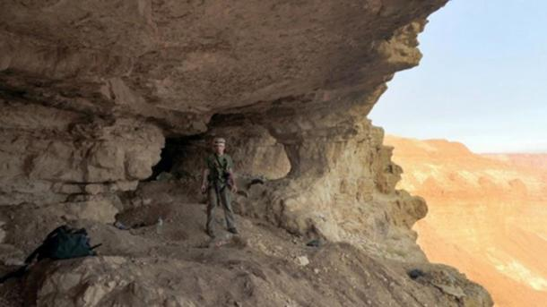 An official at the Cave of Skulls