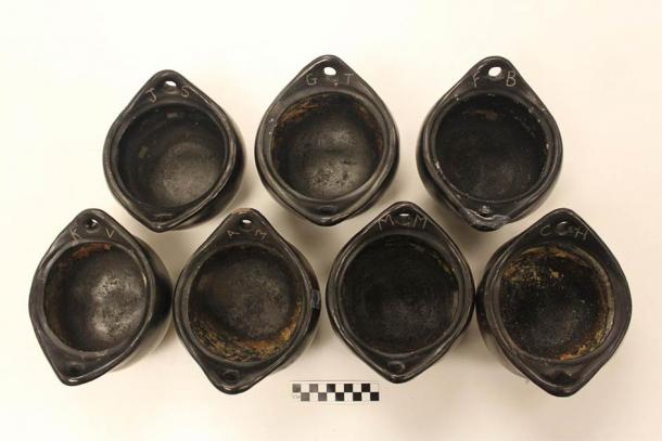 La Chamba unglazed ceramic pots which were used in a yearlong cooking experiment analyzing chemical residues from meals. Source: Melanie Miller / Nature