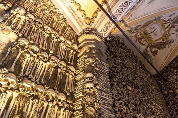 Chapel of Bones in Portugal where a vast wall of bones and skulls are displayed. (Sergii Figurnyi / Adobe)