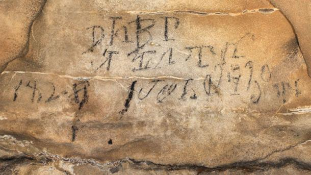 """Cherokee inscriptions - this syllabary was translated as """"leaders of the stickball team on the 30th day in their month April 1828."""" Source: A. Cressler / Fair Use."""