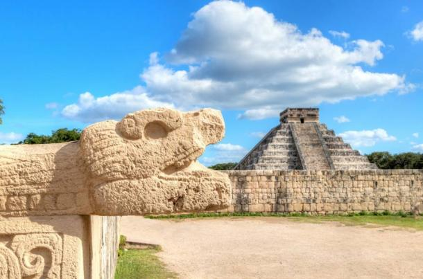 Chichen Itza Snake Head and Pyramid of Kukulcan on the edge of the Yucatan Peninsula, Mexico facing the se