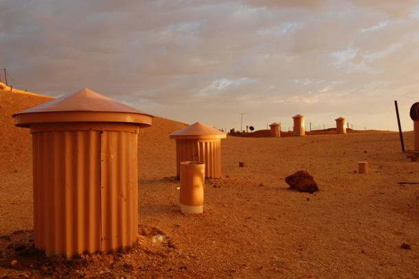 Chimneys of underground homes and buildings poke out of the ground in Coober Pedy