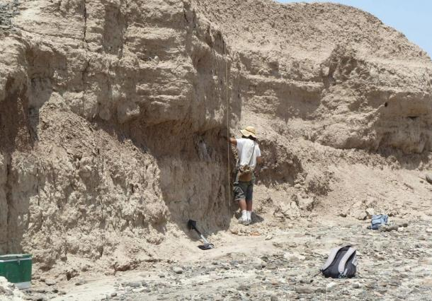 The stone tools were precisely dated by analyzing soil layers around the finds. Chris Lepre of Columbia University's Lamont-Doherty Earth Observatory (back to camera).