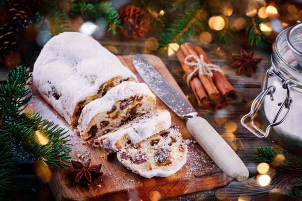 Traditional Christmas stollen fruitcake. (nblxer / Adobe Stock)