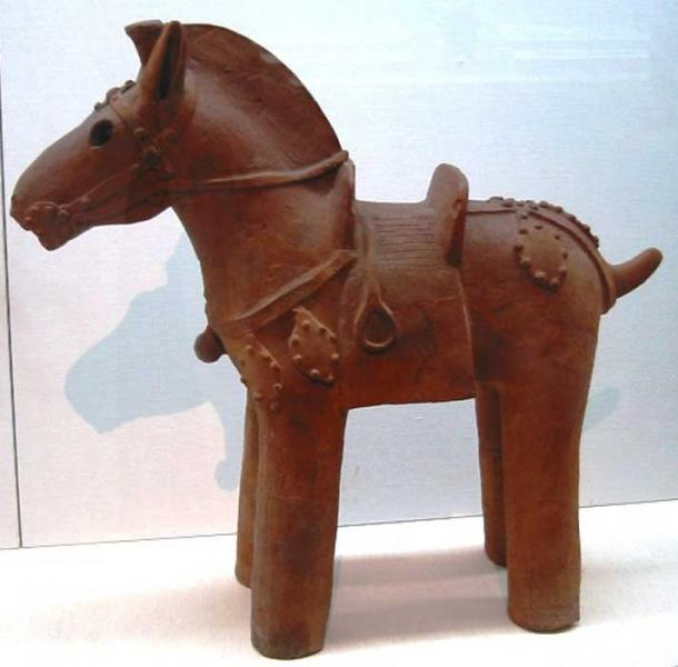 Clay horse statuette, complete with saddle and stirrups. A haniwa, from the Kofun period (6th century) in the history of Japan.