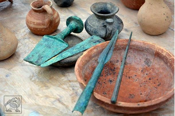 Clay vessels and bronze weapons uncovered at Grakliani Hill, which has been under excavation for eight years.