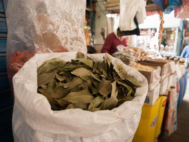Coca leaves for sale at a market in Peru (zeljka / Adobe Stock)