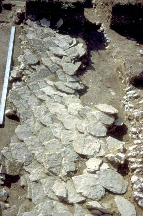 Collapsed tiles from the limestone roof