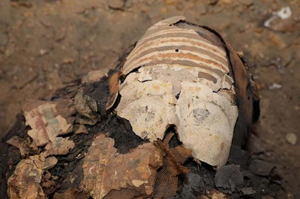 Colored cartonnage over the face of one of the mummies