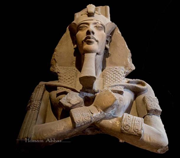 Colossal sandstone statue of Akhenaten discovered at Karnak in 1925 by Maurice Pillet, French architect and director of works for the Egyptian Antiquities Service. Head with nemes and four plumes and upper torso, the distinguishing feature being the squared-off (instead of rounded) wig-like lappets and tail of the nemes headdress. Not only the philosophy of Atenism, but the ritualistic silence the king apparently maintained has for long baffled scholars. Egyptian Museum, Cairo.