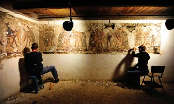 Conservation work on the Ixil Maya wall paintings in house #3 in 2015.    (Source: R. Słaboński / Antiquity Publications Ltd)