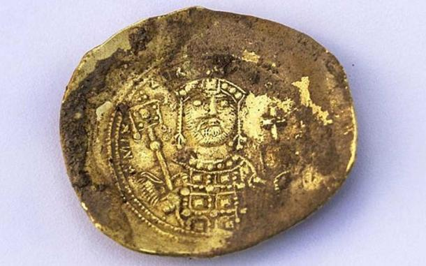 Convex-shaped gold 'nomisma histamenon' coin minted by the Byzantine emperor Michael VII Doukas (1071 – 1079 AD) that was recently unearthed at the Caesarea Maritima archaeological site. (Yaniv Berman, courtesy of the Caesarea Development Corporation)