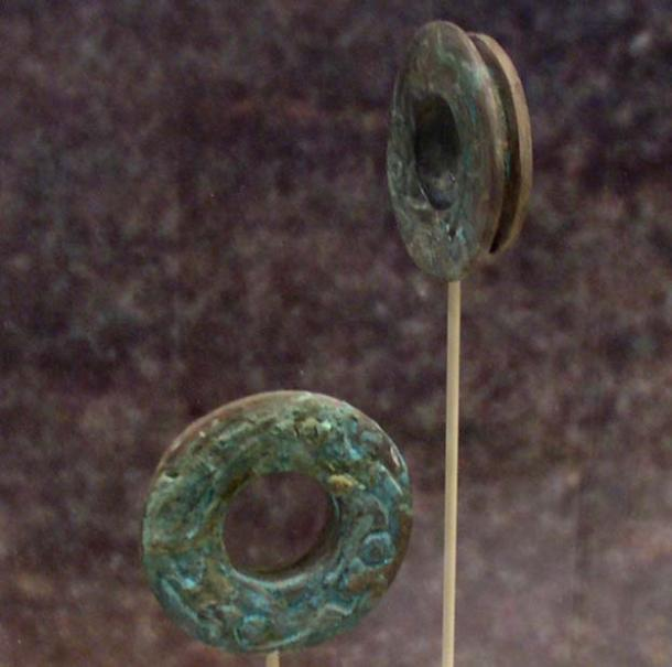Copper ear spools from Spiro Mounds, Oklahoma - Northern Caddoan Mississippian archaeological site located in Eastern Oklahoma. Representational image.