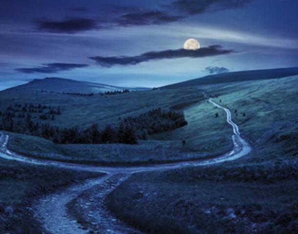 Coprnice gather at crossroads under a full moon, to bring misfortune to people who encounter them. (Pellinni / Adobe Stock)