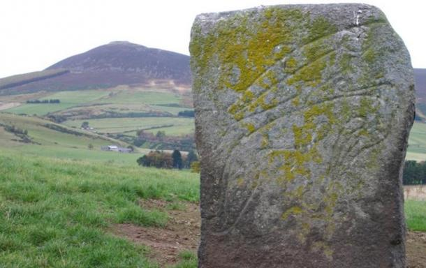 "The ""Craw Stane"", a Pictish symbol stone depicting a salmon and an unknown animal."