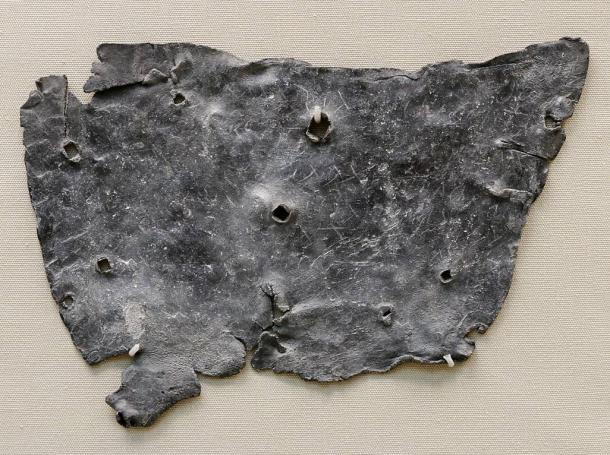 """Curse Tablet found in London. Inscription reads: """"I curse Tretia Maria and her life and mind and memory and liver and lungs mixed up together, and her words, thoughts and memory; thus may she be unable to speak what things are concealed, nor be able."""""""