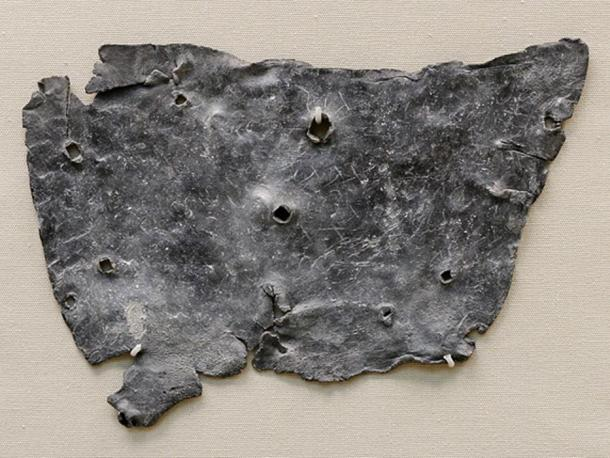 """urse Tablet found in London. Inscription reads: """"I curse Tretia Maria and her life and mind and memory and liver and lungs mixed up together, and her words, thoughts and memory; thus may she be unable to speak what things are concealed, nor be able."""" (Translation: British Museum)."""