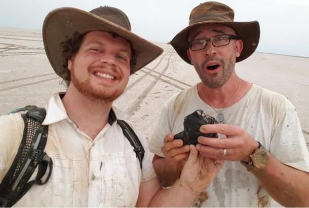 Curtin University researchers Robert Howie and Phil Bland (L to R) show off the 4.5-billion-year-old meteorite.