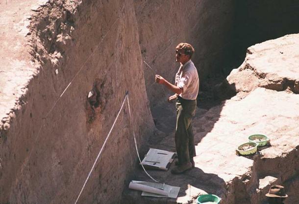 Cuyler Young measuring the deep sounding at the Godin Tepe ruins, Iran.