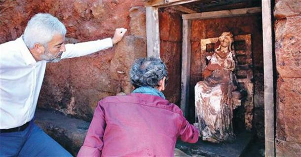 Examining the Cybele statue in Ordu, Turkey.