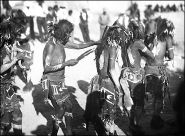 "Dancers and ""handler"" followed by ""hugger,"" Oraibi, 1896. (Author provided)"