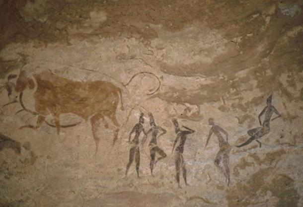 Dancing figures and animals.