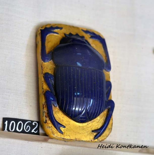 Dating to the Greco-Roman Period (332 BC- 312 AD), this scarab is perhaps the best-known type of ancient Egyptian amuletic jewel. Resting on a gilded wooden base, this particular example comprises glass paste, wood and is embellished with gold leaf. The scarab's flat surface is incised with an inscription from Chapter 30B of the Book of the Dead. Egyptian Museum, Cairo.