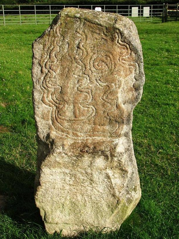 Decorated standing stone outside the southeast side of the Bryn Celli Ddu burial mound.