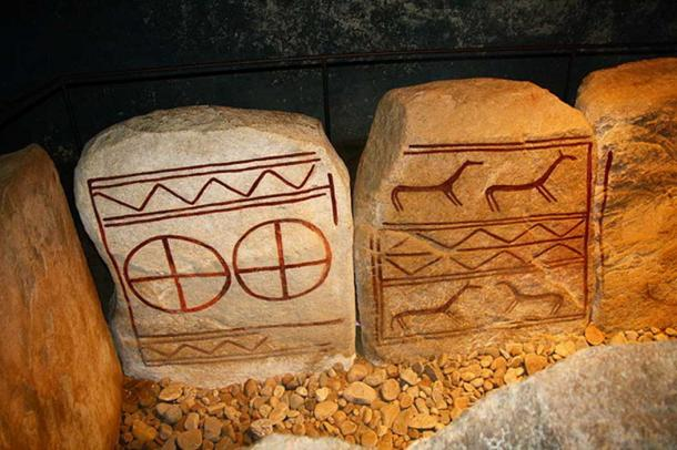 Decorated stone slabs inside The King's Grave.