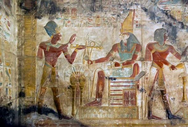Depiction of Seti I in front of Horus in Seti I's temple in Abydos.