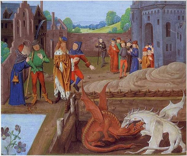 Detail from Lambeth Palace Library MS 6 folio 43v illustrating an episode in Historia Regum Britanniae (c. 1136). Pictured above Vortigern stands at the edge of a pool whence two dragons emerge, one red and one white, which do battle in his presence. (Public Domain)