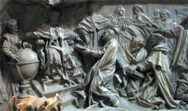 Detail of by Pope Gregory XIII's tomb by Camillo Rusconi (completed 1723); Antonio Lilio is genuflecting before the pope, presenting his printed calendar.