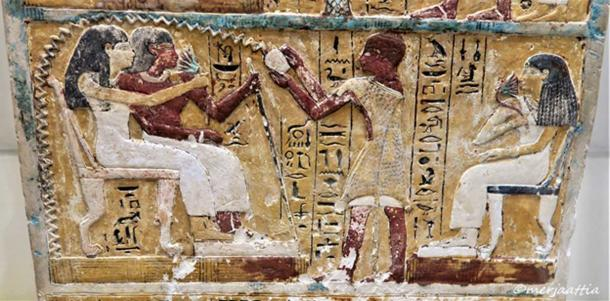 Detail of the stela of Nebnakhtu and family. His son, Amenhotep, a priest of Harsaphes, is clothed in a leopard skin and accompanied by his mother Sheritre; while he pours a libation over his father and paternal grandmother, Iuty. New Kingdom. From Sedment el-Gebel. Egyptian Museum, Cairo.