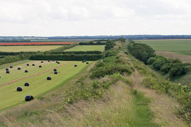 The Devil Dyke is a man-made artificial linear earthen bank which runs in a straight line for over seven miles. Despite many investigations, the origin and reason for the great ditch still baffles many experts. (Rob Mills / CC BY-NC-SA 2.0)