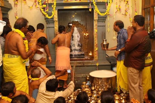 Devotees anoint the statue with milk and pray for blessings