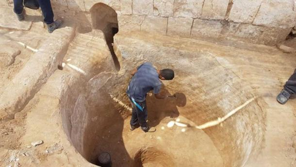 Digging in the ancient 1,600-year-old wine press in Ramat Negev, summer 2017. (Tali Gini, Israel Antiquities Authority)