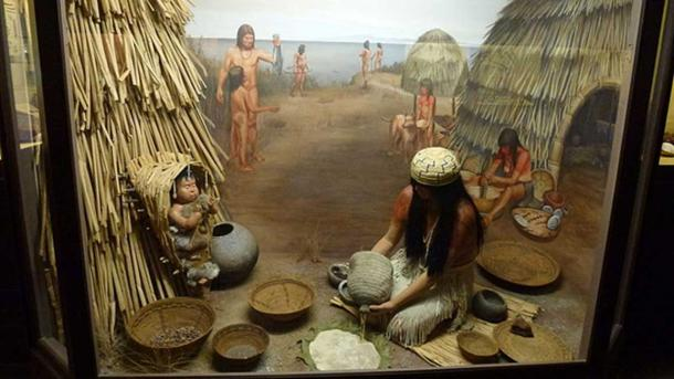 Diorama showing a Chumash Indian mother and baby.