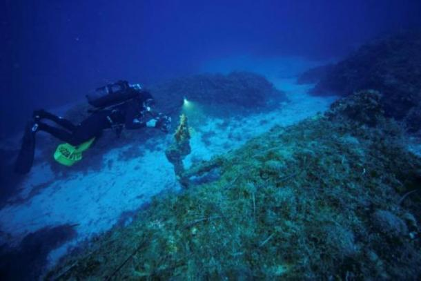 Diver, director and cinematographer Anastasis Agathos, 47, films an anchor at a shipwreck site on the island of Fournoi, Greece, September 18, 2018. Picture taken September 18, 2018. Vassilis Mentogiannis/Hellenic Ephorate of Underwater Antiquities