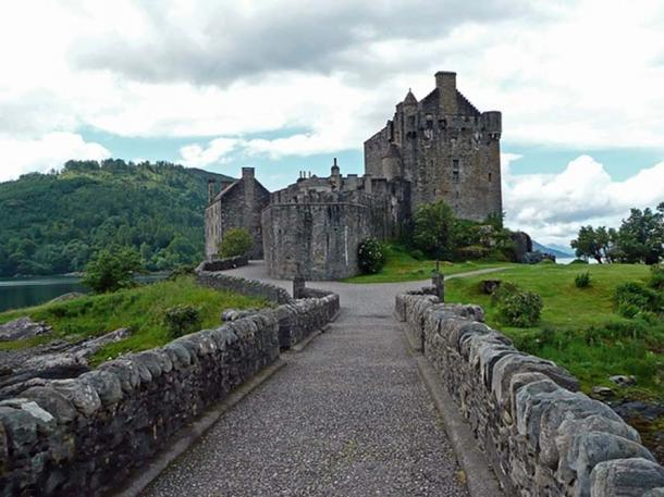 Eilean Donan Castle, Castle, Scotland. It was in ruins, and was restored between 1912-1932.
