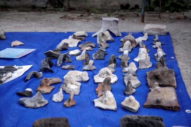 Dozens of artifacts were raised from the lake, which was located on the ancient Old Silk Road.