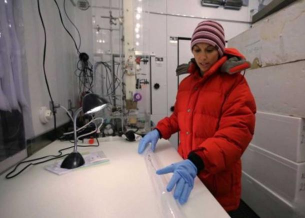 Dr. Monica Arienzo inspects an ice core sample in the ice core lab at the Desert Research Institute in Reno, Nev. (DRI)